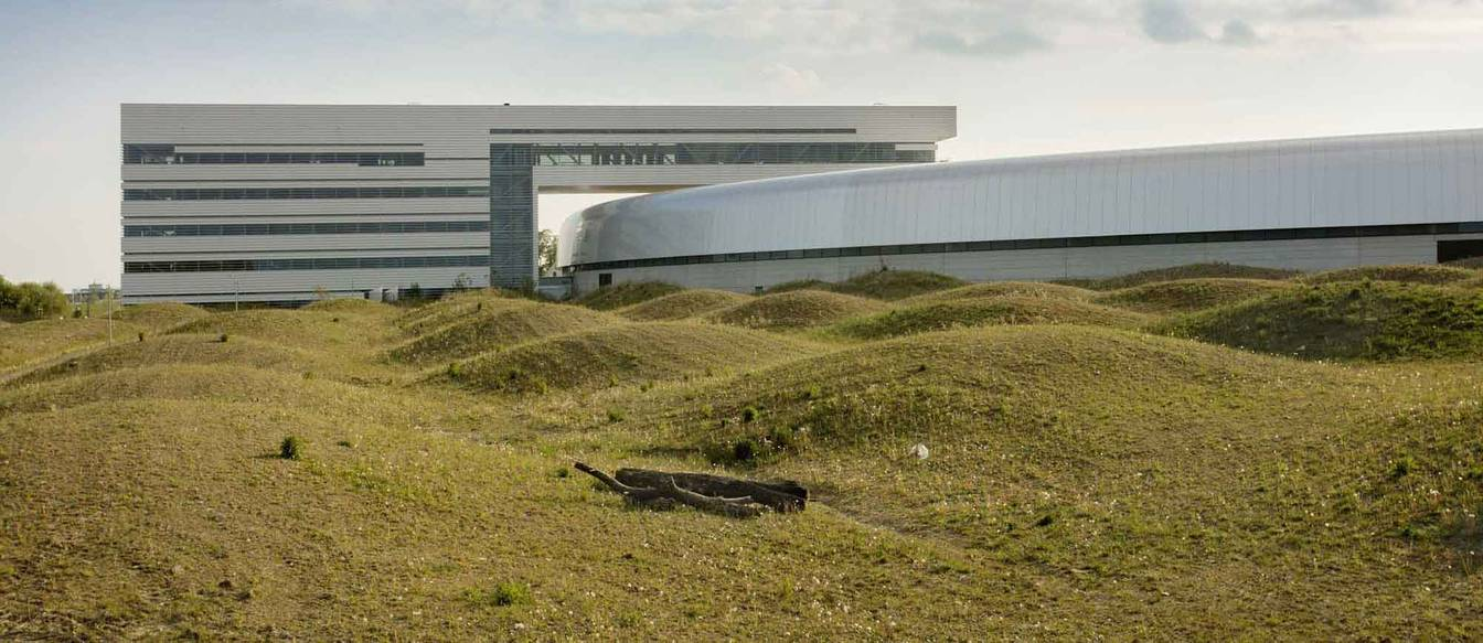 The MAX Lab facility uses a rippled spiral of topographic form to surround the main building.
